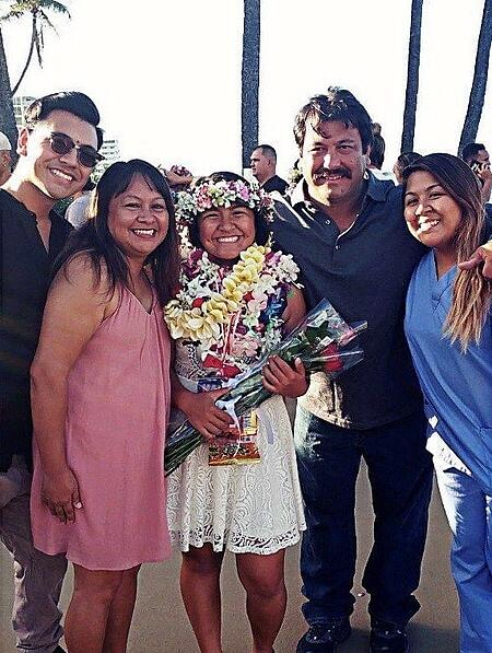 Kaela Higa and her family at her sister's graduation in Hawaii.