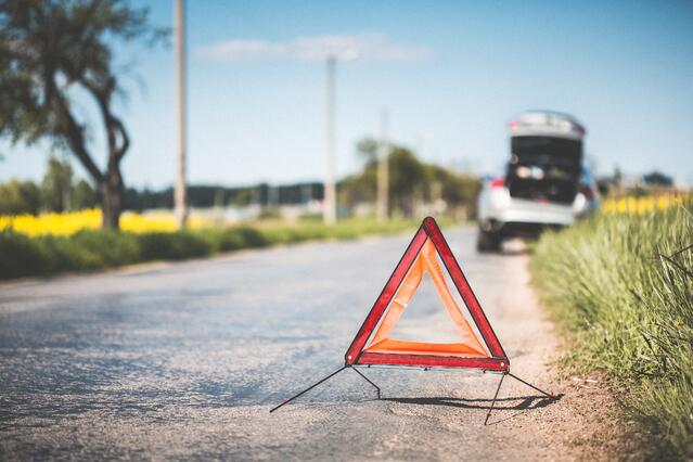 red-warning-triangle-and-broken-car-at-the-side-of-the-road-picjumbo-com.jpg