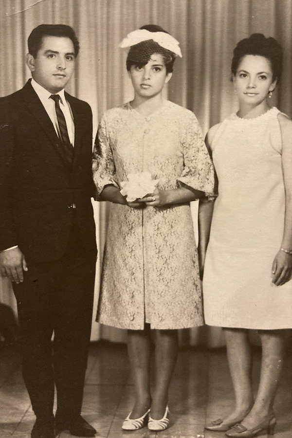 Claudia's mother (middle) at her quincenera with her godparents.