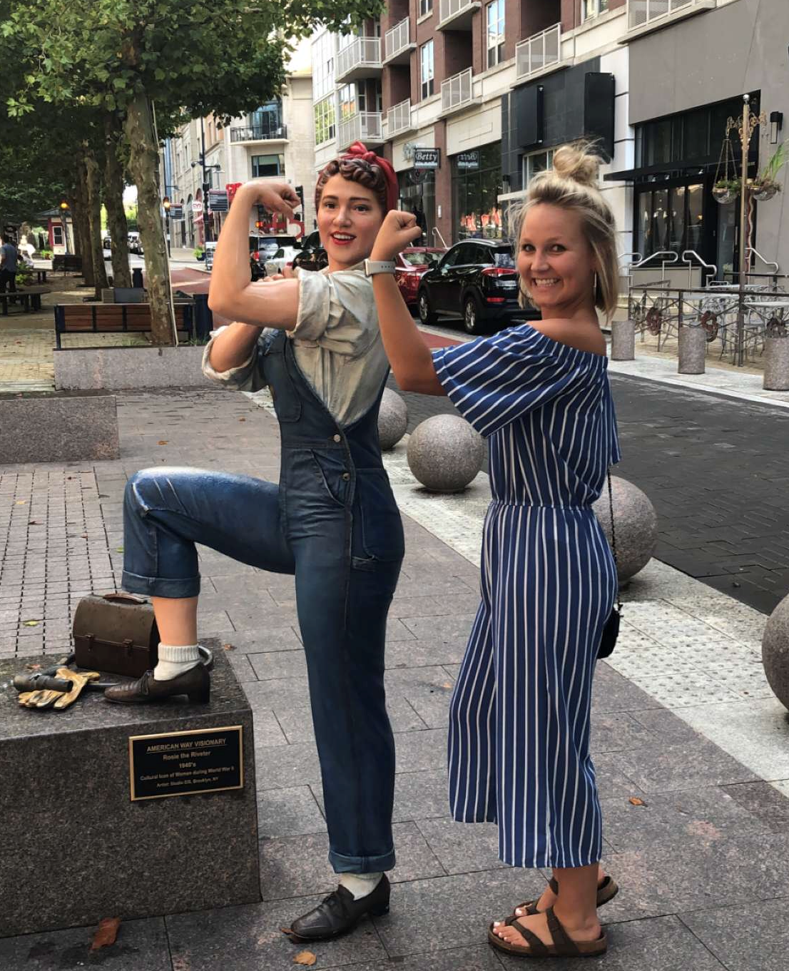 Brooke at the National Harbor in Maryland posing with a picture of Rosie the Riveter, the classic depiction of women in the 1940s who went to work in factories during WWII. Rosie is a great role model because she represents women's independence in the workplace!