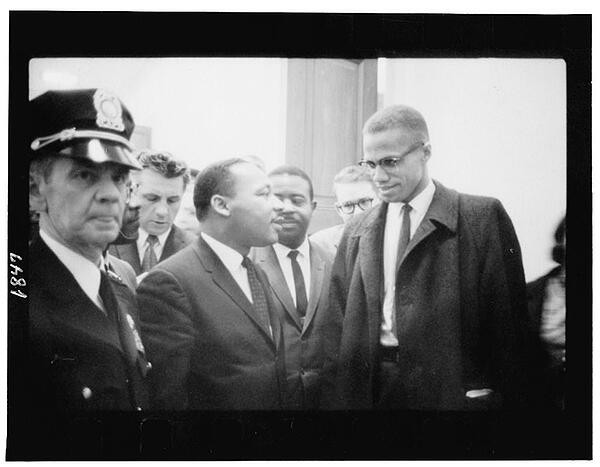 Dr. Martin Luther King, Jr. and Malcolm X waiting for press conference.