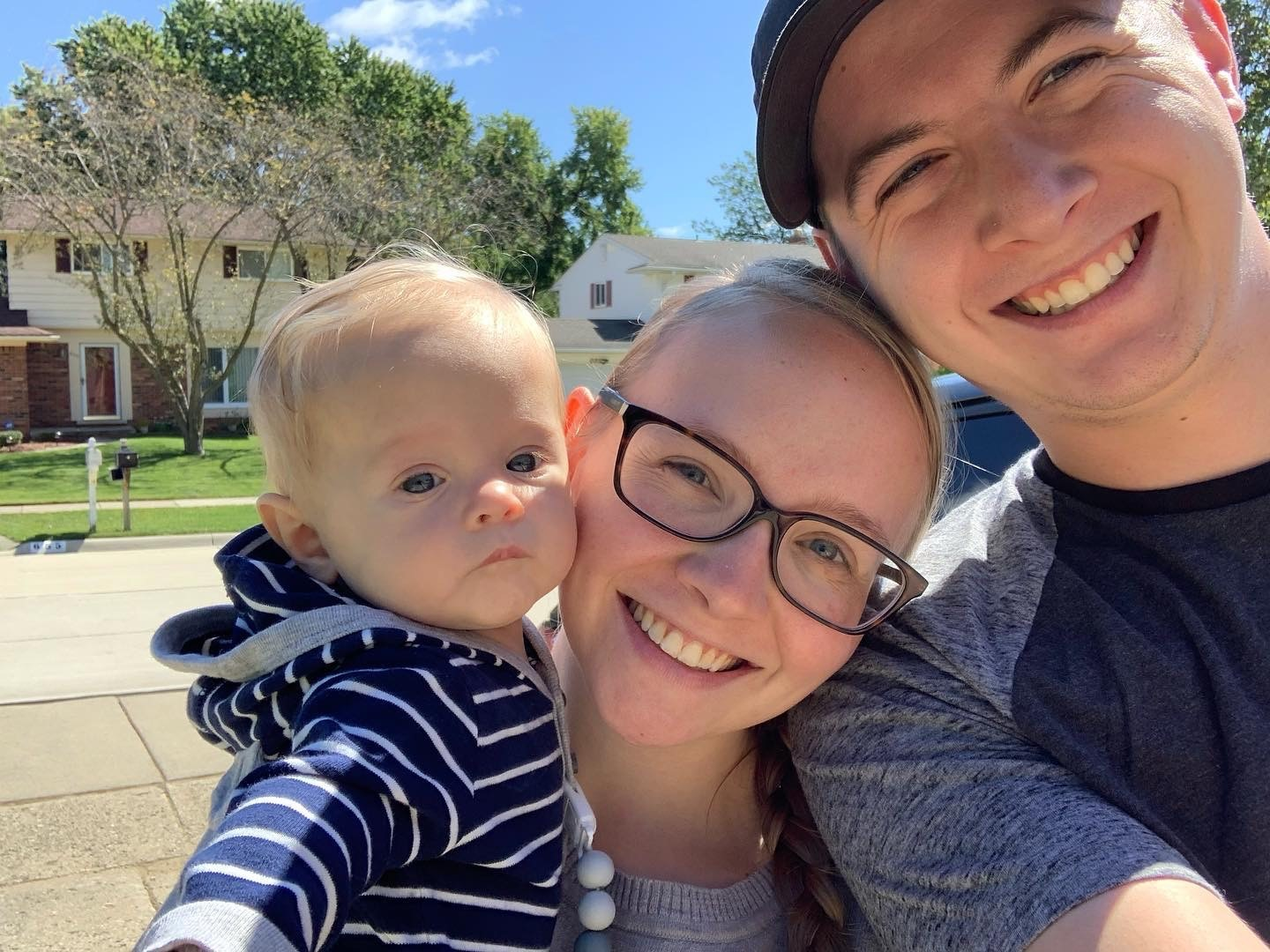 Austin McCool with his wife and son. Austin is a customer experience coordinator at Populus Group.in